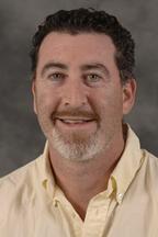 Andrew Coburn Assistant Director